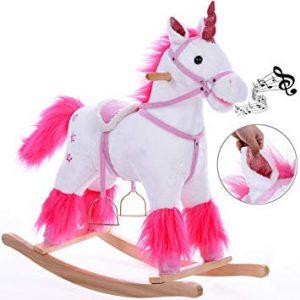 Cette licorne à bascule est de couleur blanche et rose.