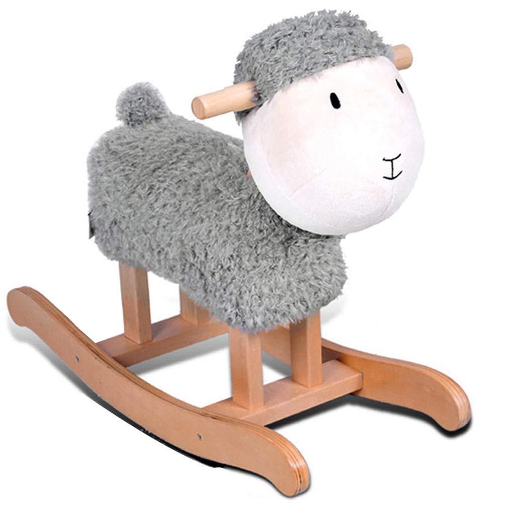 Ce mouton à bascule est de couleur grise et banche.